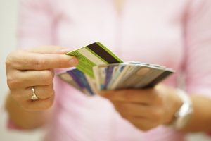 woman choosing one credit card from many,
