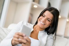 21 online consultation stock-photo-84814673-woman-at-home-texting-on-her-mobile-phone